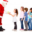 Santa giving Christmas presents — Stock Photo