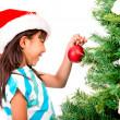 Girl decorating the Christmas tree — Stock Photo