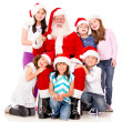 Santa with a group of kids — Stock Photo