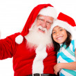 Happy Santa with a girl — Stock Photo #15659655