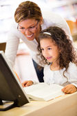 Girl learning to use technology — Stock Photo