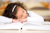 Tired girl reading a book — Stock Photo