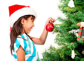 Girl decorating the Christmas tree — Stock Photo