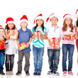 Kids with Christmas presents — Stockfoto