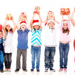 Excited children with Christmas gifts - Stock Photo