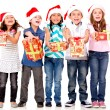 Stock Photo: Generous Christmas kids