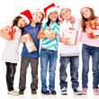 Happy children with Christmas gifts  — Stok fotoğraf