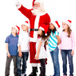 Santa showing something to kids — Stock Photo