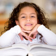 Stock Photo: Little girl reading a book