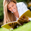 Stock Photo: Woman reading outdoors