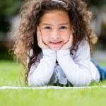 Little girl studying outdoors — Stock Photo