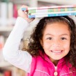 Stock Photo: Happy girl at library