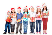Kids with Christmas presents — Stock Photo