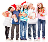 Happy children with Christmas gifts — Stock Photo
