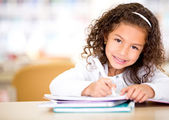 Little girl studying — Stock fotografie