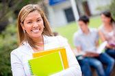 Studentin sucht glücklich — Stockfoto