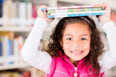 Happy girl at the library — Stock Photo