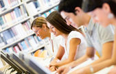 Students researching at the library — Foto Stock