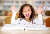 Excited girl reading a book — Stock Photo