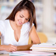 Woman studying at the library — Stock Photo #15832747