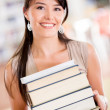 Happy student carrying books Happy student carrying books — Stock Photo