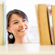 Stock Photo: Womlooking for book Womlooking for book