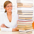 Geeky student at the library Geeky student at the library - Stock Photo
