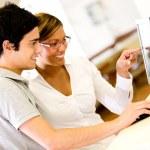 Students using a computer Students using a computer — Stock Photo #15836709