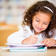 Girl studying at school Girl studying at school — Stockfoto #15837963