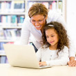 ICT teacher with a student ICT teacher with a student — Stock Photo #15838001