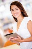 Woman with an e-book reader Woman with an e-book reader — Stock Photo