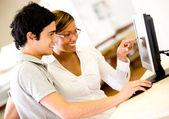 Students using a computer Students using a computer — Stock Photo
