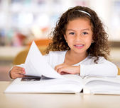 Happy girl reading a book Happy girl reading a book — Stockfoto