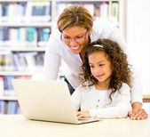 ICT teacher with a student ICT teacher with a student — Stock Photo
