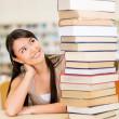 Student with a pile of books Student with a pile of books — Stock Photo #15949741