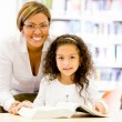 Teacher with a young student Teacher with a young student  — Stock Photo