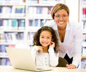 Girl with a computers teacher Girl with a computers teacher — Stock Photo