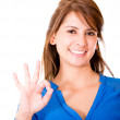 Stock Photo: Woman with an ok sign Woman with an ok sign