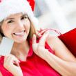 Woman shopping for Christmas Woman shopping for Christmas — Stock Photo