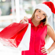 Happy woman with her Christmas purchases Happy woman with her Christmas purchases — Stock Photo