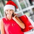 Female Santa shopping Female Santa shopping — Stock Photo