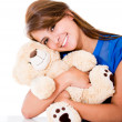 Sweet woman with a teddy bear Sweet woman with a teddy bear — Stock Photo