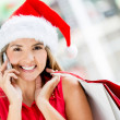 Royalty-Free Stock Photo: Female shopper on Christmas Female shopper on Christmas