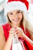 Female Santa on a shopping spree Female Santa on a shopping spree — Stock Photo