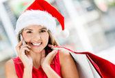 Vrouwelijke shopper op kerstmis vrouwelijke shopper op kerstmis — Stockfoto