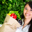 Stock Photo: Woman shopping for groceries Woman shopping for groceries