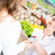 Woman paying at the supermarket Woman paying at the supermarket — Stock Photo