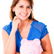 Stock Photo: Womwith piggybank Womwith piggybank
