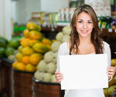 Woman with an open sign at her business Woman with an open sign at her business — Stock Photo