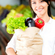 Stock Photo: Female shopper with groceries Female shopper with groceries